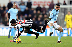 Newcastle United's Mikel Merino (left) and Manchester City's Gabriel Jesus (right) battle for the ball during the Premier League match at St James' Park, Newcastle.