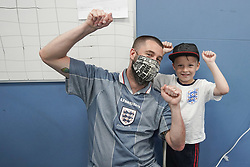 """© Licensed to London News Pictures. 03/07/2021. Sheffield, UK.. Nick Davy and his son Albert Davy,5, react after receiving the second dose of the Pfizer/BioNTech vaccine at a pop-up vaccination clinic at Hillsborough Stadium in Sheffield as part of the """"Grab a jab"""" campaign. Photo credit: Ioannis Alexopoulos/LNP<br /> <br /> **Permission Granted"""