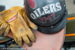 Kelly Modlin's riding gear at the finish of  Stage 6 of the Motorcycle Cannonball Cross-Country Endurance Run, which on this day ran from Cape Girardeau to Sedalia, MO., USA. Wednesday, September 10, 2014.  Photography ©2014 Michael Lichter.