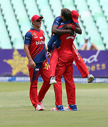Eddie Leiei celebrates with Dwaine Pretoriousduring the T20 Challenge cricket match between the Lions and the Warriors at the Kingsmead stadium in Durban, KwaZulu Natal, South Africa on the 4th December 2016<br /> <br /> Photo by:   Steve Haag / Real Time Images