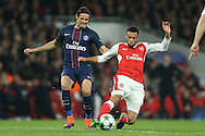 Francis Coquelin of Arsenal is challenged by Edinson Cavani of Paris Saint-Germain. UEFA Champions league group A match, Arsenal v Paris Saint Germain at the Emirates Stadium in London on Wednesday 23rd November 2016.<br /> pic by John Patrick Fletcher, Andrew Orchard sports photography.