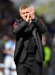 Manchester United Manager Ole Gunnar Solskjaer applauds the fans after the final whistle of the Premier League match at the John Smith's Stadium, Huddersfield.
