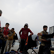 A group of Afghans is seen been escorted out of a rescue boat arriving at Mytilene port in Lesbos island, Greece.