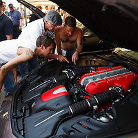 The Ferrari FF has its engine checked out by enthusiasts at Goodwood FOS 2013