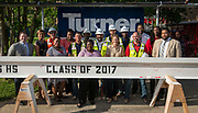 Beam signing and placement at Yates High School, April 20, 2017.