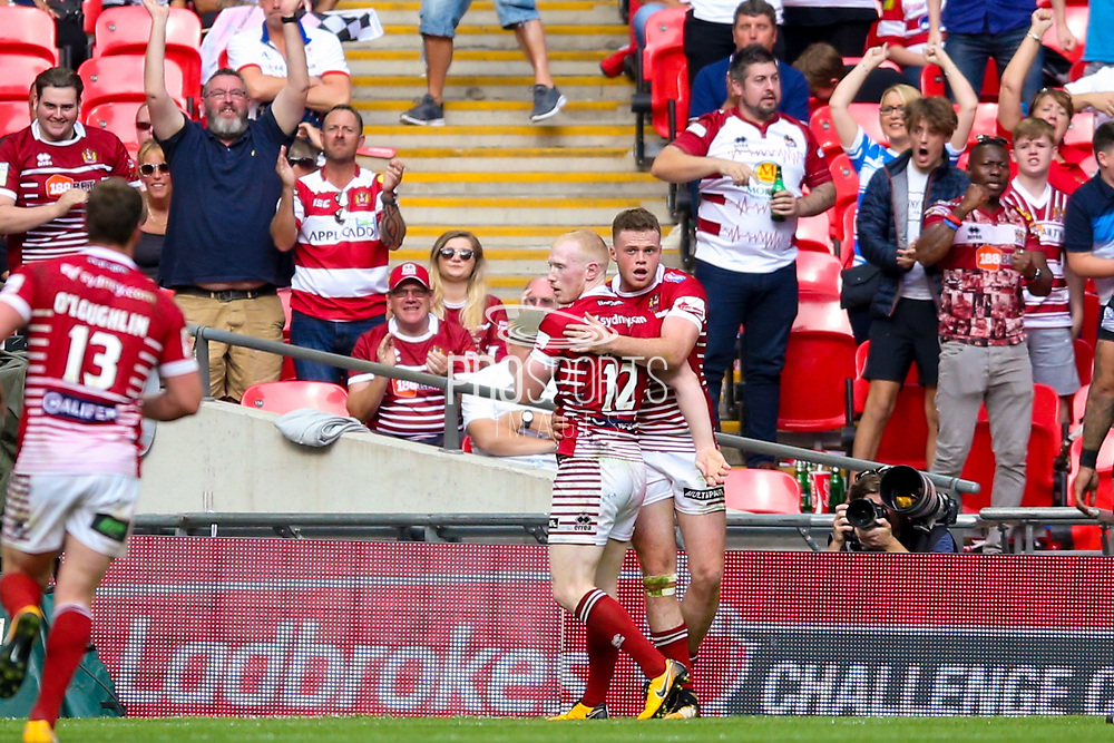 Wigan Warriors left wing Joe Burgess (5) goes over late on and scores a try to make the score 18-14 during the Ladbrokes Challenge Cup Final 2017 match between Hull RFC and Wigan Warriors at Wembley Stadium, London, England on 26 August 2017. Photo by Simon Davies.