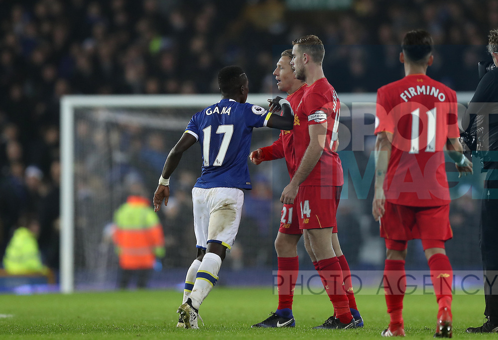 Idrissa Gueye of Everton clashes with Lucas Leiva of Liverpool after the English Premier League match at Goodison Park, Liverpool. Picture date: December 19th, 2016. Photo credit should read: Lynne Cameron/Sportimage