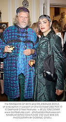 The MARQUESS OF BATH and MS.AMANDA DOYLE, at a reception in London on 2nd October 2002.PDS 13