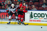 KELOWNA, BC - FEBRUARY 8: Simon Knak #36 of the Portland Winterhawks is checked by Kyle Topping #24 of the Kelowna Rockets at Prospera Place on February 8, 2020 in Kelowna, Canada. (Photo by Marissa Baecker/Shoot the Breeze)