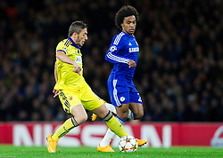 Willian of Chelsea vs Agim Ibraimi of Maribor during football match between Chelsea FC and NK Maribor, SLO in Group G of Group Stage of UEFA Champions League 2014/15, on October 21, 2014 in Stamford Bridge Stadium, London, Great Britain. Photo by Vid Ponikvar / Sportida.com