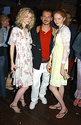 Left to right, model PORTIA FREEMAN, MATTHEW WILLIAMSON and Model LILY COLE at a party to celebrate the launch of the new Matthew Williamson fragrance held at Harvey Nichols, Knightsbridge, London on 14th June 2005.<br /><br />NON EXCLUSIVE - WORLD RIGHTS