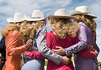 Miss Rodeo Wyoming Erin Heffron, left, poses for one of dozens of photographs with other state queens at a the Frontier Days Queens Luncheon in Cheyenne, a gathering of more than 50 rodeo royalty title holders and their friends and family.