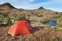 Red tent at campsite near John Day River Burnt Ranch, Oregon