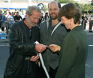 Actor Peter Mullan distributes tickets to his friends at the UGC cinema before the gala screening of his latest film 'Young Adam. The screening marks the opening of the annual Edinburgh International Film Festival which runs until 24th August.