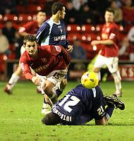 Photo:Mark Stephenson,Walsall fc v Swindon Town.<br />Coca Cola league 2,9-12-2006<br />Walsalls Kris Taylor(L) Takes on Swindons Lucas Jutkiewicz.