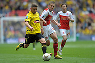 Burton Albion's Alex MacDonald (l) breaks away from Fleetwood Town's Charlie Taylor . Skybet football league two play off final match , Burton Albion v Fleetwood Town at Wembley Stadium in  London on Monday 26th May 2014.<br /> pic by John Patrick Fletcher, Andrew Orchard sports photography.