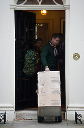 © London News Pictures. 12/12/2012. London, UK.   Wine glasses- Trolley number five of five containing alcoholic drinks and glasses being delivered to 11 Downing Street by Majestic wines on December 12, 2012. Photo credit: Ben Cawthra/LNP