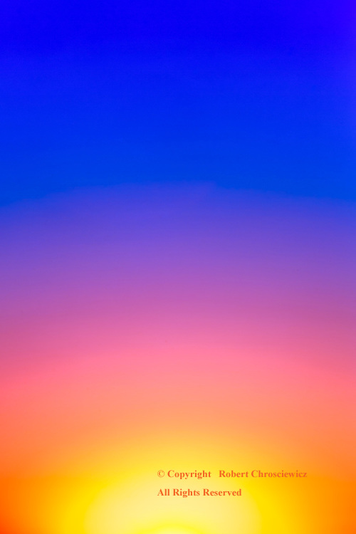 Morning Spectrum: The full spectrum of colour is seen radiating from the early morning sun in Delta, British Columbia Canada.