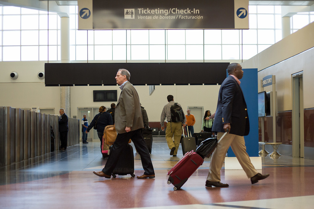 Travels make their way through the domestic north terminal  of Hartsfield–Jackson Atlanta International Airport on Friday, March 27, 2015 in Atlanta, Ga.  Photo by Kevin Liles for The New York Times
