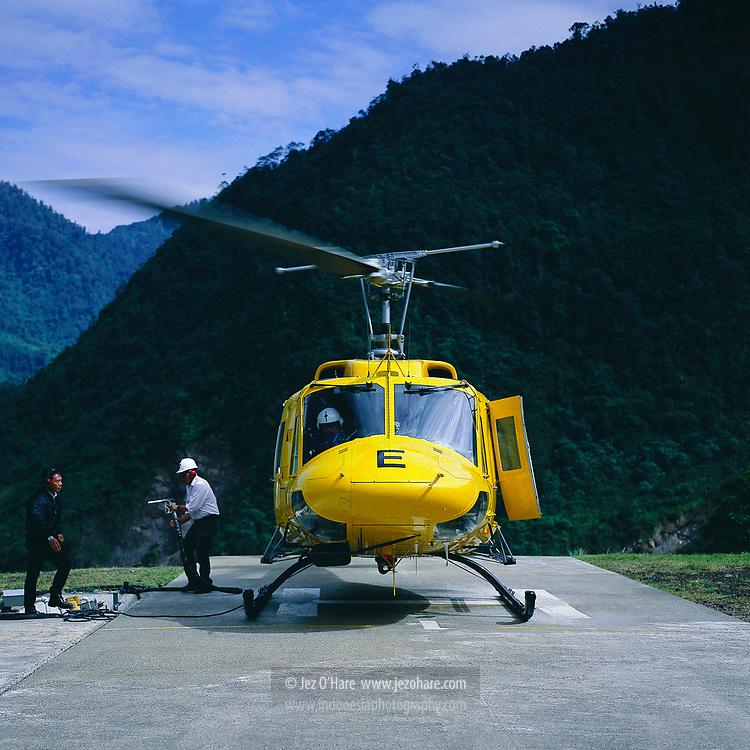 Capt. Djoko Prasetyo refueling a Freeport Bell 212 Helicopter at Tembagapura Helipad, Papua, Mimika, Indonesia.