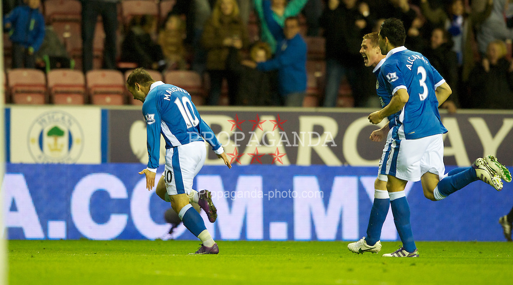 WIGAN, ENGLAND - Wednesday, April 11, 2012: Wigan Athletic's Shaun Maloney celebrates scoring the only goal against Manchester United during the Premiership match at the DW Stadium. (Pic by Dave Kendall/Propaganda)