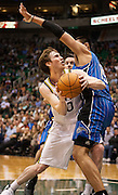 Jazz guard Gordon Hayward (20) drives the lane against Magic forward Gustavo Ayon (19) during the first half of the NBA basketball game between the Utah Jazz and the Orlando Magic at Energy Solutions Arena, Wednesday, Dec. 5, 2012.