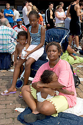 31st August, 2005. 'Hell on earth.' The Superdome in New Orleans, Louisiana where over 20,000 refugees from hurricane Katrina are crammed into hellish conditions. Mother Chanita Jones with her children, Samyra (1 yr), Bashon (2yrs) and Chanese (11yrs) amidst the mass trapped in the Superdome.