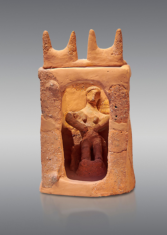 Minoan clay model shrine depicting a priestess playing the part of a goddess in a small single roomed house, Galatas 1700-1650 BC; Heraklion Archaeological  Museum, grey background. .<br /> <br /> If you prefer to buy from our ALAMY PHOTO LIBRARY  Collection visit : https://www.alamy.com/portfolio/paul-williams-funkystock/minoan-art-artefacts.html . Type -   Heraklion   - into the LOWER SEARCH WITHIN GALLERY box. Refine search by adding background colour, place, museum etc<br /> <br /> Visit our MINOAN ART PHOTO COLLECTIONS for more photos to download  as wall art prints https://funkystock.photoshelter.com/gallery-collection/Ancient-Minoans-Art-Artefacts-Antiquities-Historic-Places-Pictures-Images-of/C0000ricT2SU_M9w