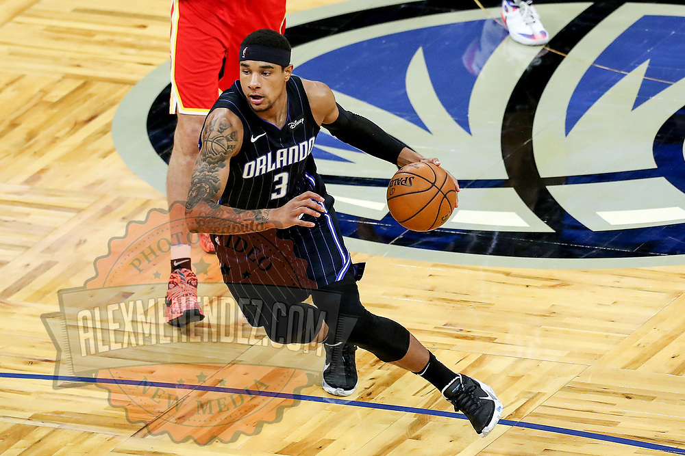 ORLANDO, FL - MARCH 03: Chuma Okeke #3 of the Orlando Magic controls the ball against the Atlanta Hawks at Amway Center on March 3, 2021 in Orlando, Florida. NOTE TO USER: User expressly acknowledges and agrees that, by downloading and or using this photograph, User is consenting to the terms and conditions of the Getty Images License Agreement. (Photo by Alex Menendez/Getty Images)*** Local Caption *** Chuma Okeke