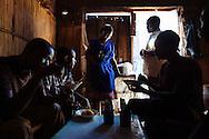 Jennifer (center) serves men breakfast at a small cafe in Gulu, Uganda.