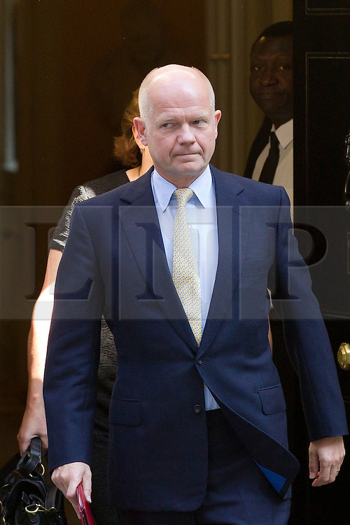"""© Licensed to London News Pictures. 29/08/2013. London, UK. William Hague, the Foreign Secretary leaves a meeting of the British cabinet on Downing Street in London today (29/08/2013) as a recalled British Parliament prepares to debate the possibility of """"direct"""" military action over recent reports an alleged chemical weapons attack in Syria. Photo credit: Matt Cetti-Roberts/LNP"""
