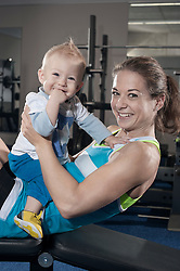 Portrait of smiling mother and her son in the gym, Bavaria, Germany