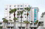 Condominiums and palm trees lining Gulf Boulevard.  North Redington Beach Tampa Bay Area Florida USA