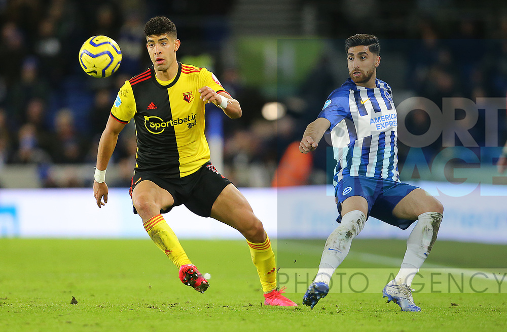 Brighton's Alireza Jahanbakhsh and Watford's Adam Masina during the Premier League match at the American Express Community Stadium, Brighton and Hove. Picture date: 8th February 2020. Picture credit should read: Paul Terry/Sportimage