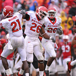 Sep 26, 2009; College Park, MD, USA; Rutgers cornerback Devin Mccourty (21) celebrates his interception with Rutgers safety Joe Lefeged (26) during the first half of Rutgers' 34-13 victory over Maryland in NCAA college football at Byrd Stadium.