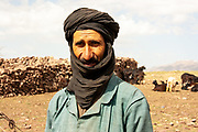 Portrait of a Moroccan shepherd and his herd of goats