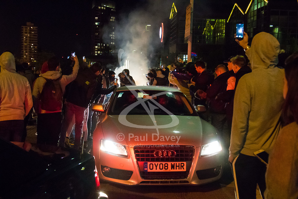 London, April 16th 2017. Hundreds of car enthusiasts gather with their souped up vehicles for the '2017 Tunnel Run', an where they take to the streets of London for a high speed 'cruise' through several of its tunnels and over bridges, cruising past famous landmarks. With complaints from some members of the public over noise and road safety grounds, police keep an eye on the drivers with the threat of siezing cars from unruly drivers. The event begins with a static meet-up at Canada Water before the cars set off on their cruise through the streets of the capital. PICTURED: An Audi emerges ahead of some bikers as smoke from a burnout rises behind them.<br /> <br /> Credit: ©Paul Davey