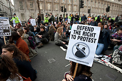 © licensed to London News Pictures. London, UK 14/03/2012. Protesters are sitting outside Downing Street at the student demonstration against tuition fees and education cuts today in central London. Photo credit: Tolga Akmen/LNP