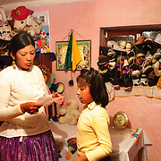 Cholita wrestler Yolanda La Amorosa  at her home in La Paz with her daughter Adriana. Yolanda is part of the 'Titans of the Ring' wrestling group who perform every  Sunday at El Alto's Multifunctional Centre. Bolivia. The wrestling group includes the fighting Cholitas, a group of Indigenous Female Lucha Libra wrestlers who fight the men as well as each other for just a few dollars appearance money. El Alto, Bolivia, 17th March 2010.