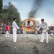 Doing a stunt demonstration. Fire jump. Pakistan's Independance Day celebration (14th August), on the Polo ground in Skardu town, Baltistan region.
