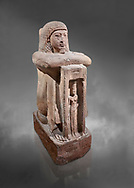 """Ancient Egyptian statue of Qen, priest of Anukis, sanstone, New Kingdom, 19th Dynasty, (1292-1191 BC), Isalnd of sehel. Egyptian Museum, Turin. Grey background.<br /> <br /> Qen was a """"gods father of Amon of Elephantine and of Khnum, Satis and Anukis"""". Elephantine is a Greek name of the present day Aswan. The naos, shrine, contains a female wearing a high plumed headdress. She is Anukis goddess of the Nile flood. With the ram-heahed god Khum and the goddess Satis, she formed the triad of the Elephantine. The statue probably comes from the temple of the Triad on Sehel Island just south of Elephantine.. Drovetti collection. Cat 3016. .<br /> <br /> If you prefer to buy from our ALAMY PHOTO LIBRARY  Collection visit : https://www.alamy.com/portfolio/paul-williams-funkystock/ancient-egyptian-art-artefacts.html  . Type -   Turin   - into the LOWER SEARCH WITHIN GALLERY box. Refine search by adding background colour, subject etc<br /> <br /> Visit our ANCIENT WORLD PHOTO COLLECTIONS for more photos to download or buy as wall art prints https://funkystock.photoshelter.com/gallery-collection/Ancient-World-Art-Antiquities-Historic-Sites-Pictures-Images-of/C00006u26yqSkDOM"""