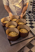 MILANO, The makning of Panettone. Pavè. Giovanni Giberti, one of the three owners of the Cafeteria. Panettone dought ready for the oven