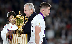 England's Owen Farrell walks past the Webb Ellis Cup during the 2019 Rugby World Cup final match at Yokohama Stadium.
