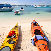 Colorful sea kayaks on the sandy beach at Cruz Bay on St. John in the US Virgin Islands.