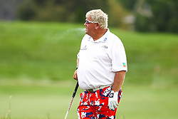 August 3, 2018 - Blaine, MN, U.S. - BLAINE, MN - AUGUST 03: John Daly smokes a cigarette before his tee shot during the first round of the 3M Championship on August 3, 2018 at TPC Twin Cities in Blaine, Minnesota. (Photo by David Berding/Icon Sportswire) (Credit Image: © David Berding/Icon SMI via ZUMA Press)