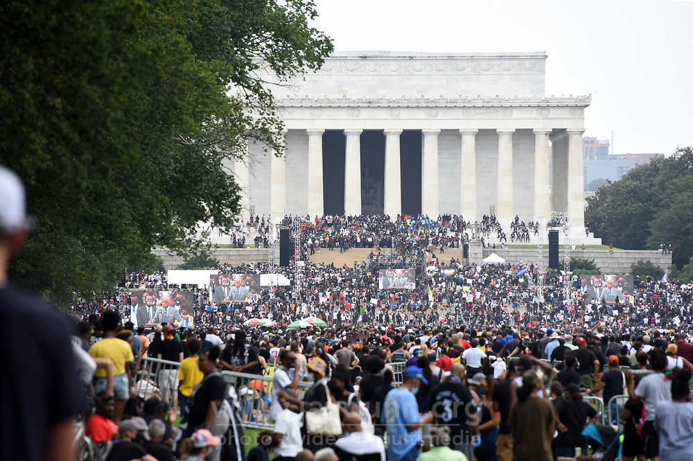 """On Friday, August 28th, 2020, thousands of people from all over the country attended the Commitment March in Washington, D.C.to fight for criminal justice reform in solidarity with those who have lost loved ones at the hands of the police and to push for federal legislation against misconduct. The event, organized by the Reverend Al Sharpton and the National Action Network under the rallying call 'Get Your Knee Off Our Necks,' coincides with and honors the 57thanniversary of Martin Luther King, Jr.'s March on Washington, where he delivered his historic """"I Have A Dream"""" speech in 1963."""