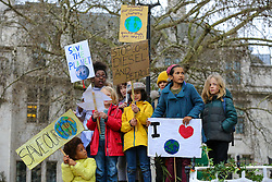 © Licensed to London News Pictures. 23/02/2019. London, UK. Hundreds of students with placards take part in a climate change protest in Parliament Square, highlighting the dangers of climate change. Photo credit: Dinendra Haria/LNP
