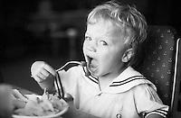 September 1994, Paris, France --- Young Child Eating With Fork --- Image by © Owen Franken/CORBIS