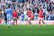 Barnsley players react to Luke Thomas of Coventry City (23) scoring a goal to make the score 2-2 during the EFL Sky Bet League 1 match between Barnsley and Coventry City at Oakwell, Barnsley, England on 30 March 2019.