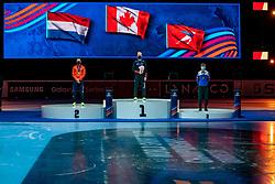 Charles Hamelin CAN gold medal, Itzhak de Laat of Netherlands silver and Semen Elistratov of Russia bronze medal on 1500 meter during ceremony ISU World Short Track speed skating Championships on March 06, 2021 in Dordrecht